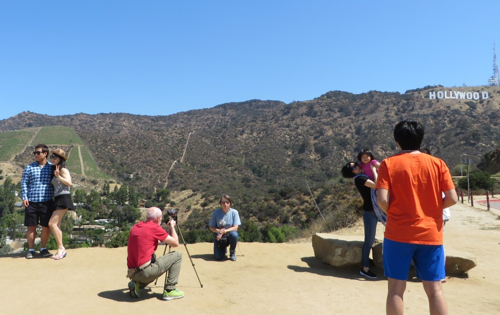 People taking pictures of people taking pictures at the Hollywood sign
